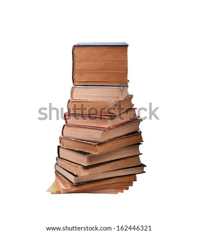 A few old books, stacked, isolated on a white background