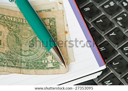 A few old US banknotes on a notebook