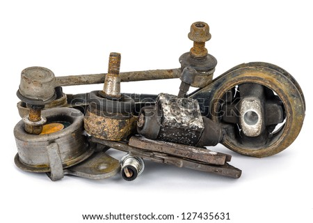 A few old, worn out and rusty car parts - stock photo