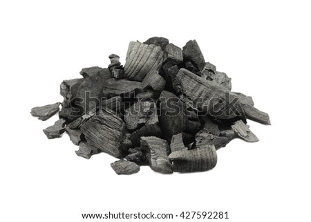 a few pieces of black charcoal on white background - stock photo