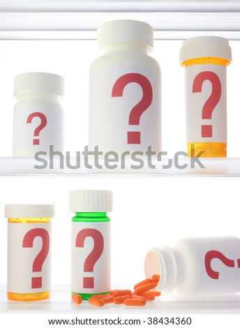 A few pill bottles in a medicine cabinet, all labeled with red question marks. One bottle is on its side with pills spilling out. - stock photo
