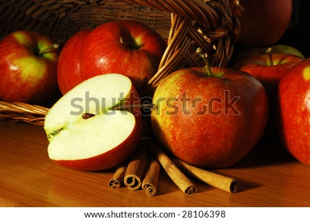 A few red apples with a cinnamon - stock photo