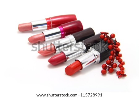 A few shades of lipstick in a row isolated on white background - stock photo