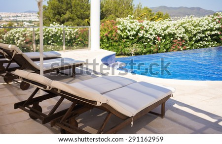 a few sun loungers by the pool