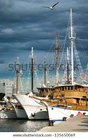 a few wooden boats docked closely together for the night - stock photo