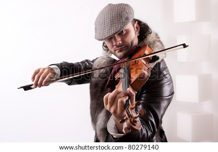 A fiddler playing his instrument - stock photo