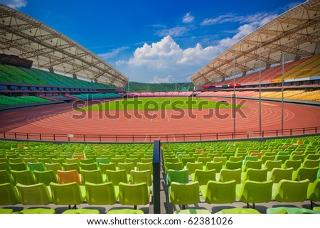 A field of empty seats in a open stadium in china outdoor. - stock photo