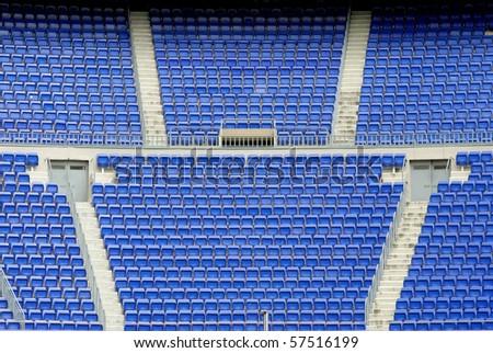 A field of empty seats on the stadium corner - stock photo