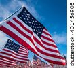A field of hundreds of American flags.  Commemorating veteran's day, memorial day or 9/11. - stock photo