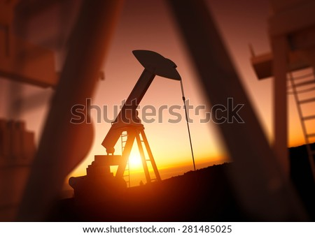 A field of oil pumps against a sunset.  - stock photo