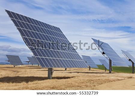 A field of photovoltaic solar panels providing alternative green energy - stock photo