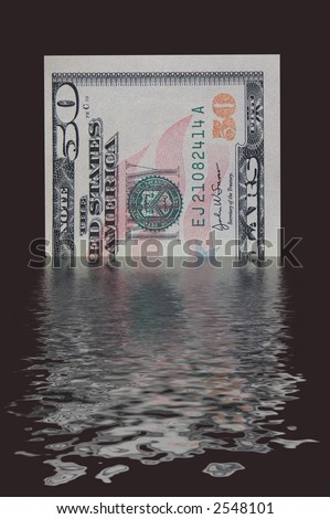 A fifty dollar bill melting into a pool - stock photo