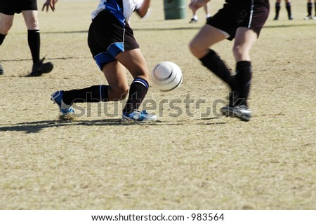 A fight for the soccer ball in a youth soccer game. - stock photo