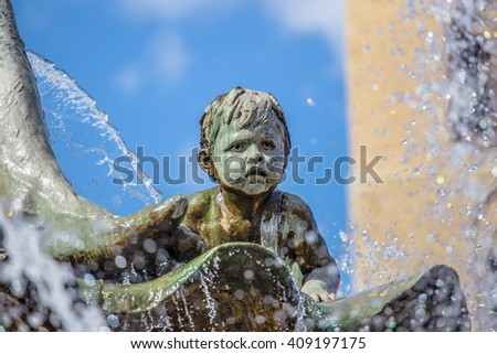 A figure from Neptune Fountain in Berlin - stock photo