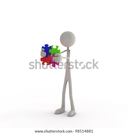 a figure is holding a puzzle piece in his hands - stock photo