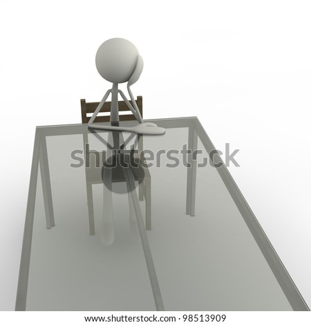 a figure is sitting bored at the table - stock photo