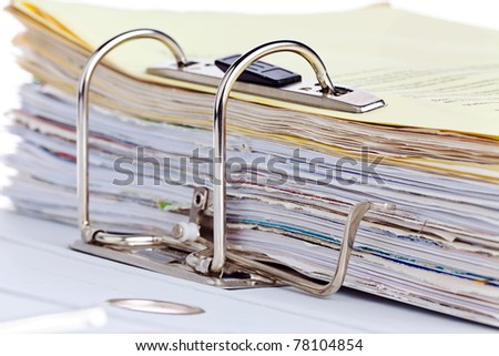 A file folder with documents and papers. Retention of contracts. - stock photo