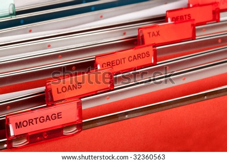 A filing cabinet showing finance related files - stock photo