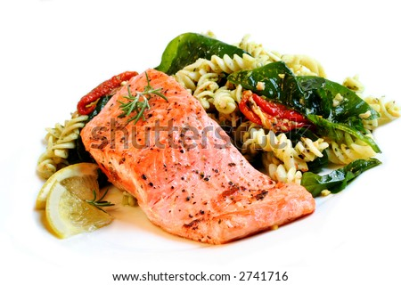 A fillet of Atlantic salmon, perfectly cooked, with a fresh pasta salad. - stock photo