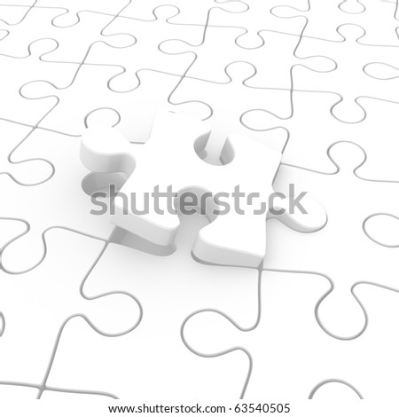 A final puzzle piece half inserted - stock photo