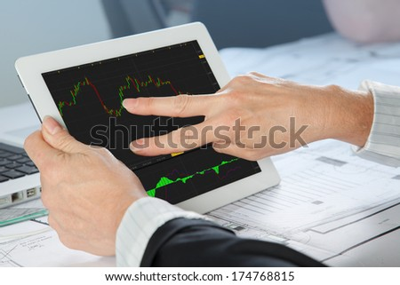 A Finance Analyst is analyzing a share momentum. - stock photo
