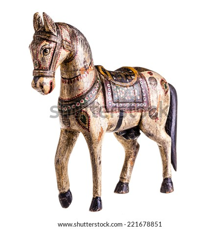 a finely decorated ancient wooden horse isolated over a white background - stock photo
