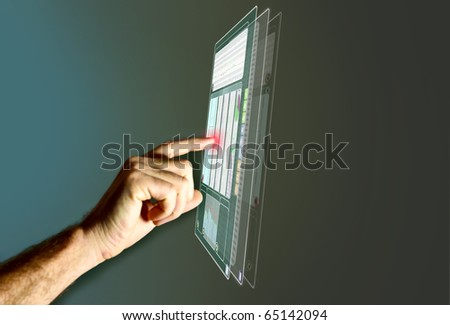 a finger points on a virtual display - stock photo