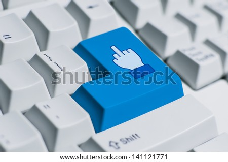 A finger sign for saying F word on the keyboard. This is fully social media era. - stock photo
