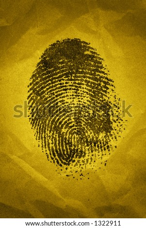 A fingerprint on a textured background with dramatic lighting - stock photo