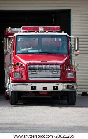 A fire engine parked and ready to roll - stock photo