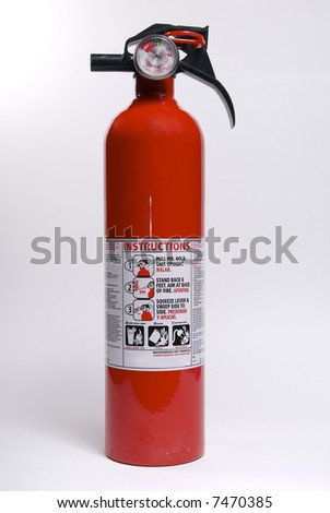 A fire extinguisher isolated against a white background. - stock photo