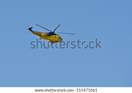 A fire fighting helicopter flies back to base after fighting fire in the Douglas Complex forest fires near Glendale Oregon - stock photo