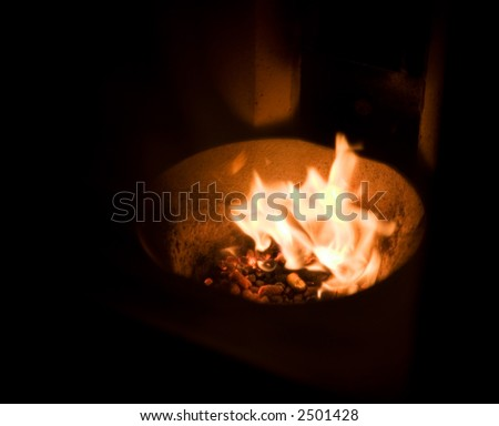 A fire place fueled by burning pellets - stock photo