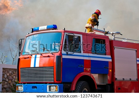 A fire-truck arrived at a burning - stock photo