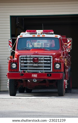 A fire truck parked and ready to roll - stock photo