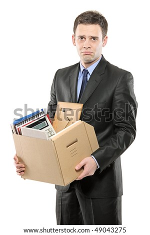 A fired man in a suit carrying a box of personal items isolated on white - stock photo