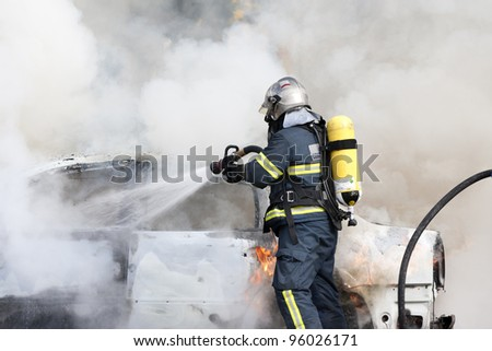 a firefighter putting out a fire
