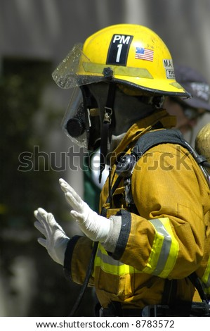 A firefighter signals his crew. - stock photo