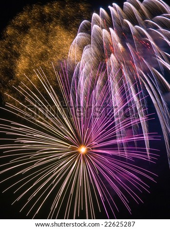 A fireworks display during a big celebration - stock photo