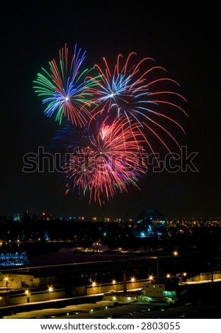 A fireworks display over the Old Port of Montreal - stock photo