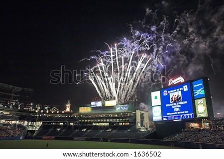 a fireworks display over Turner Field, in Atlanta, Georgia - stock photo
