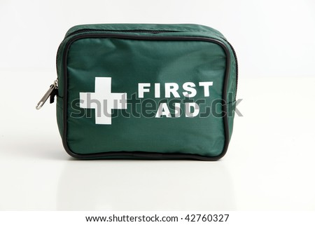 A first aid kit bag isolated on a white with soft reflection - stock photo