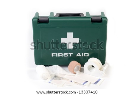 A first aid kit with bandages and plasters - stock photo