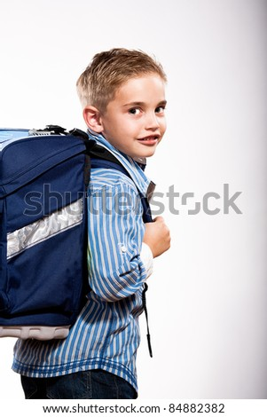 a first grader school boy with school bag