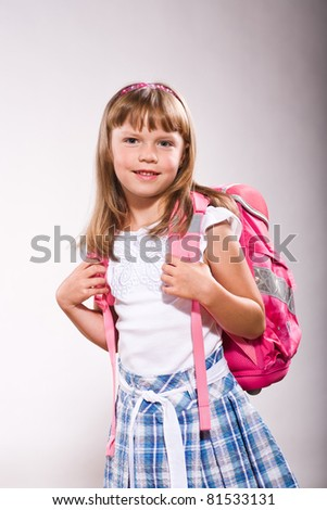 a first grader school girl with school bag
