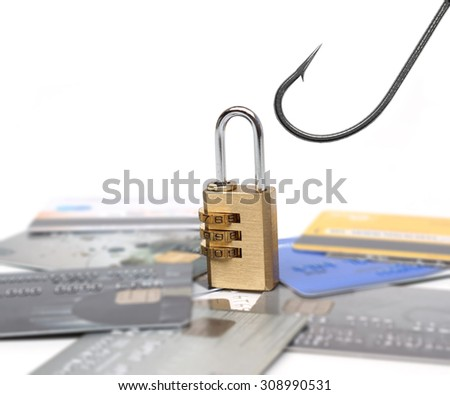 a fish hook over a pile of credit cards  with a security lock - credit card phishing attack                                - stock photo
