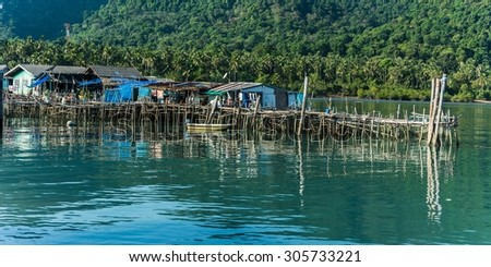a fisher village on stilts in cambodia - stock photo