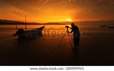 a fisherman boat and photography at the beach. image might contain softness and little noise due to long exposure - stock photo