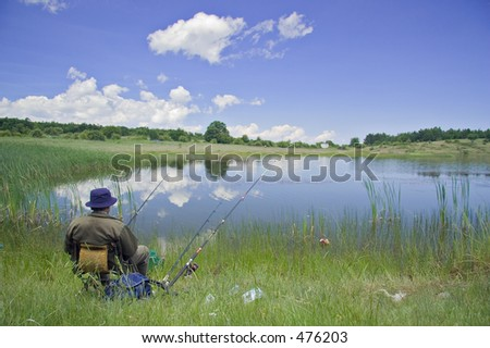 A fisherman doing some fishing - stock photo