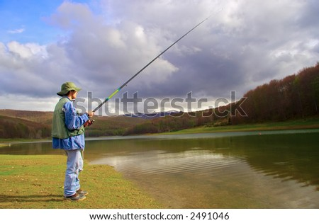 A fisherman fishing on a lake in Macedonia - stock photo